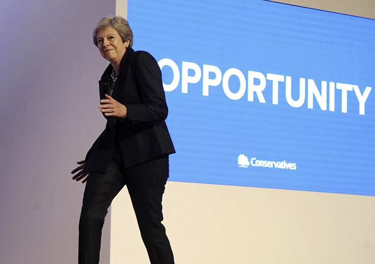 Theresa May dancing