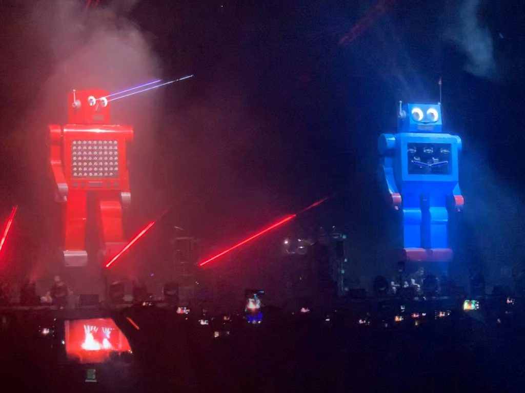 Robots overlook the crowd during The Chemical Brothers set.