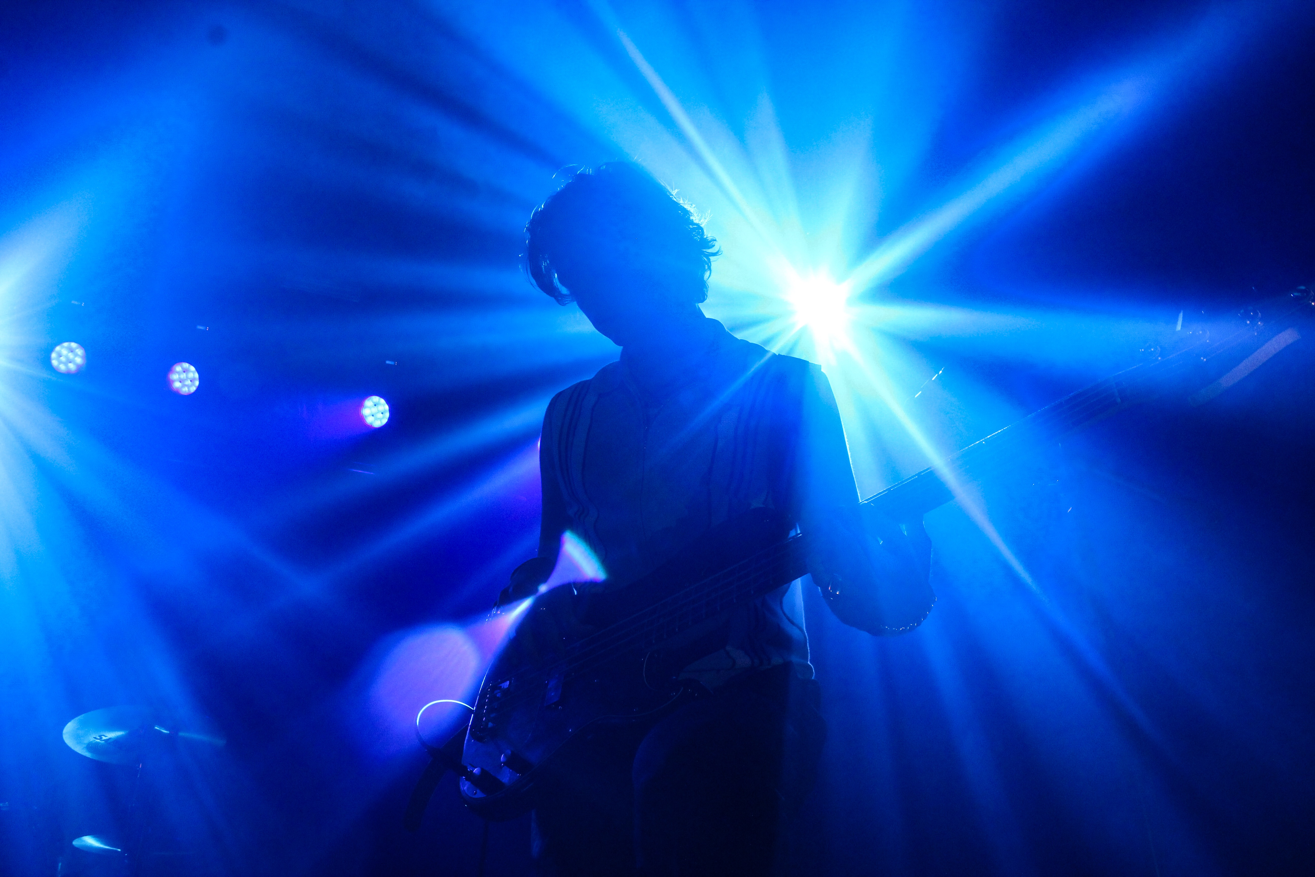 Bass player, Robert Keating shrouded in light. Photo taken by Leanne Gabriel.